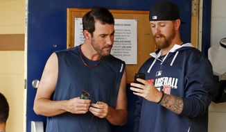 Detroit Tigers' Justin Verlander, left, and Justin Miller, stand outside their locker room while waiting for an exhibition spring training baseball game between the Tigers and the Philadelphia Phillies to be called due to rain in Lakeland, Fla., Thursday, March 6, 2014. (AP Photo/Gene J. Puskar)