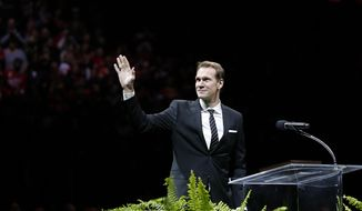 Former Detroit Red Wing Nicklas Lidstrom waves to the crowd during the retirement ceremony for his No. 5 before an NHL hockey game between the Detroit Red Wings and Colorado Avalanche at Joe Louis Arena, Thursday, March 6, 2014, in Detroit. (AP Photo/Duane Burleson)