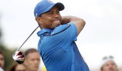 Tiger Woods hits from the second tee during the first round of the Cadillac Championship golf tournament Thursday, March 6, 2014, in Doral, Fla. (AP Photo/Marta Lavandier)