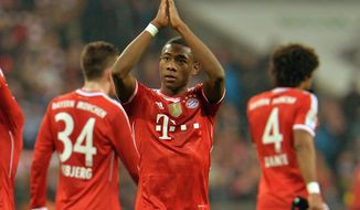 Bayern's David Alaba of Austria, center, reacts to supporters after the German first division Bundesliga soccer match between  FC Bayern Munich and FC Schalke in Munich, Germany, on Saturday, March 1,  2014. Bayern won 5-1. (AP Photo/Kerstin Joensson)