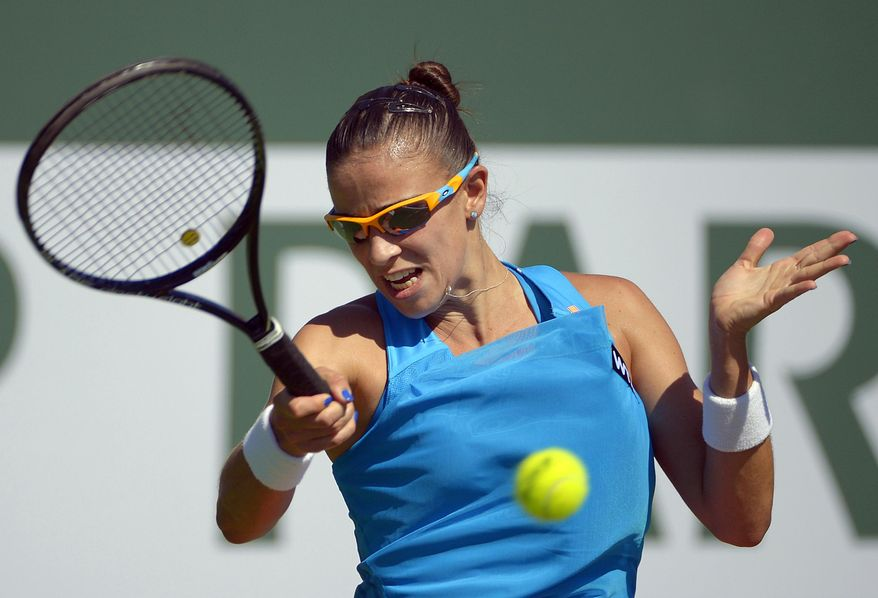 Paula Ormaechea, of Argentina, returns a shot against Zheng Jie, of China, during a first round match at the BNP Paribas Open tennis tournament, Thursday, March 6, 2014, in Indian Wells, Calif. (AP Photo/Mark J. Terrill)