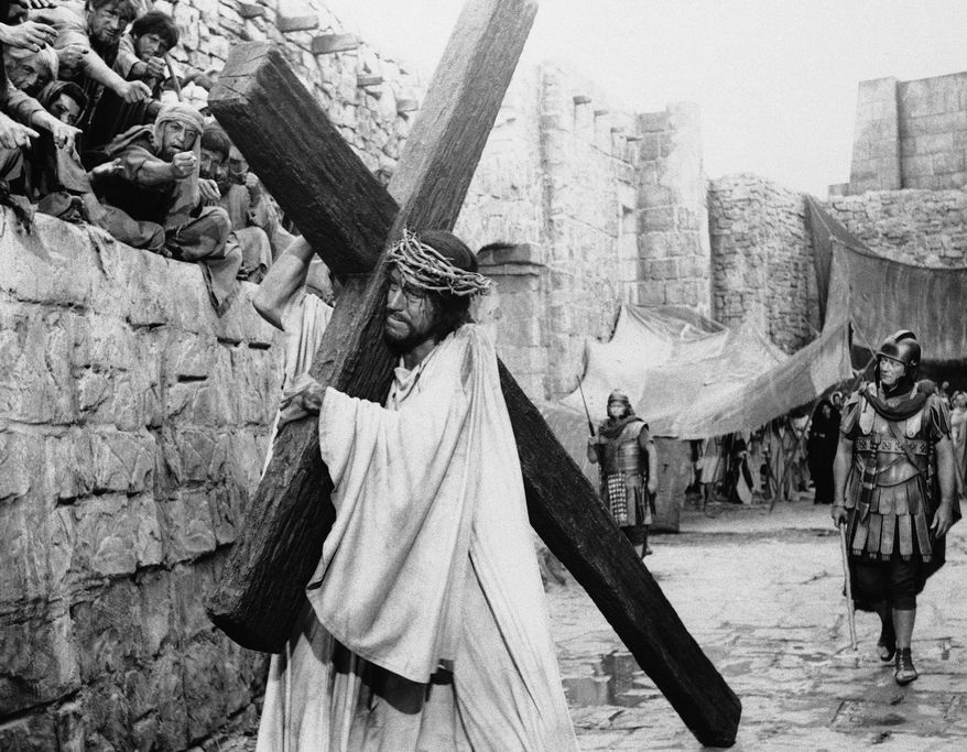 "FILE This 1965 file photo shows actor Max von Sydow as Jesus and John Wayne as the converted centurion in a scene from ""The Greatest Story Ever Told."" (AP Photo)"