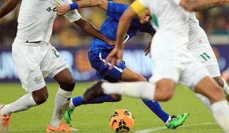 Brazil's Neymar, attacks during their international friendly soccer match against South Africa during their international friendly soccer match at Soccer City Stadium in Johannesburg, South Africa, Wednesday, March 5, 2014. Brazil beat South Africa 5-0. (AP Photo/Themba Hadebe)