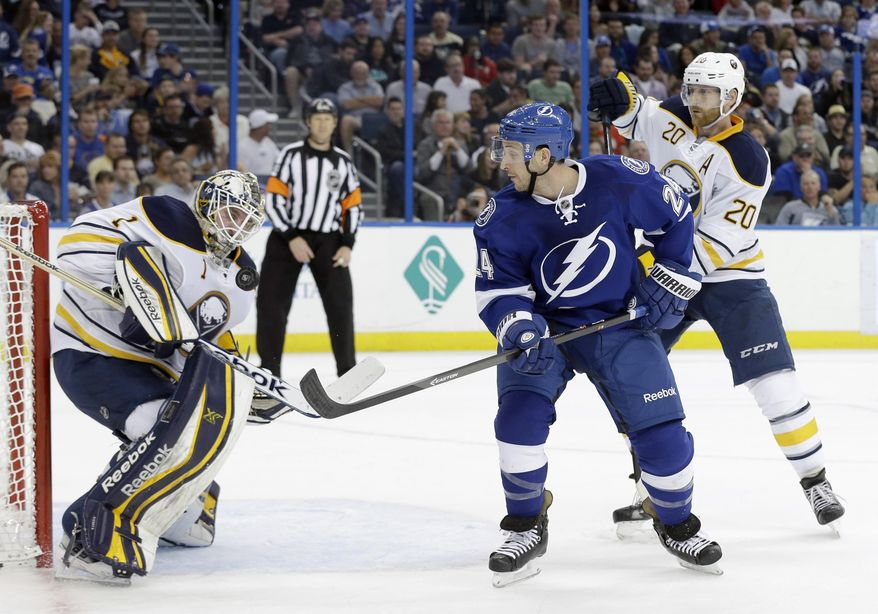 Buffalo Sabres goalie Jhonas Enroth (1), of Sweden, makes a save on a shot by Tampa Bay Lightning right wing Ryan Callahan (24) during the second period of an NHL hockey game Thursday, March 6, 2014, in Tampa, Fla. Defending for Buffalo is defenseman Henrik Tallinder (20), of Sweden. (AP Photo/Chris O'Meara)