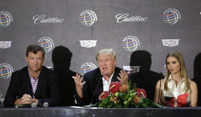 Donald Trump, center, speaks during a news conference, joined by his daughter Ivanka, right, and course architect Gil Hanse, left, about the redesign of the Blue Monster course, site of the Cadillac Championship golf tournament, Wednesday, March 5, 2014, in Doral, Fla. (AP Photo/Wilfredo Lee)
