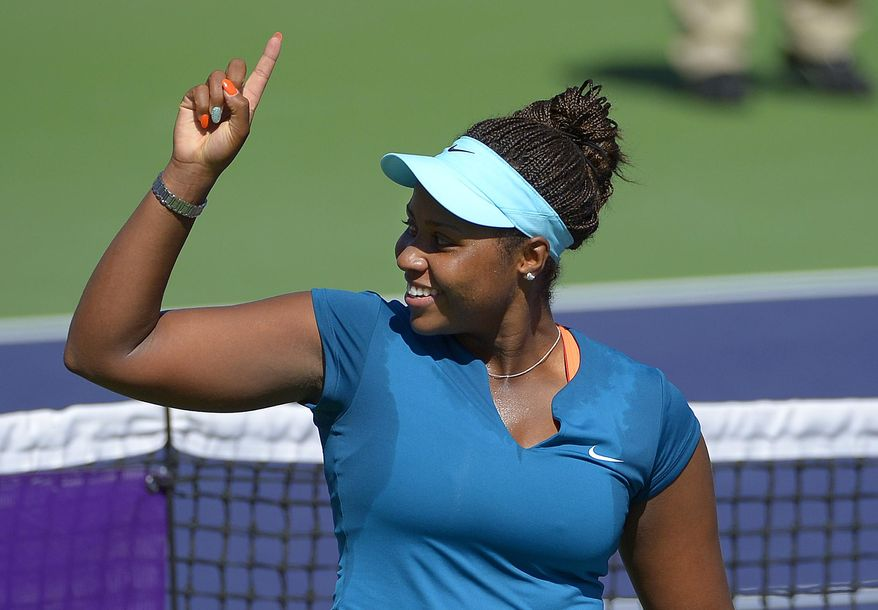 Taylor Townsend celebrates after beating Karin Knapp, of Italy, in a first round match at the BNP Paribas Open tennis tournament, Thursday, March 6, 2014, in Indian Wells, Calif. Townsend won 7-6, 6-1. (AP Photo/Mark J. Terrill)