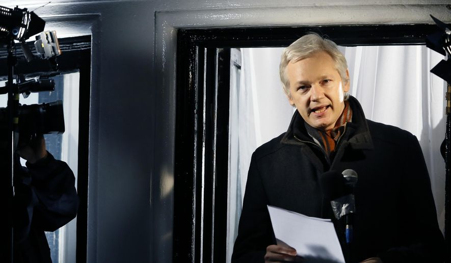 Julian Assange, founder of WikiLeaks, speaks to the media and members of the public from a balcony at the Ecuadorian Embassy in London in this Dec. 20, 2012, file photo. (AP Photo/Kirsty Wigglesworth, File)