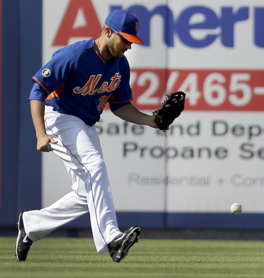 New York Mets left fielder Andrew Brown drops a ball hit by St. Louis Cardinals' Jon Jay during the sixth inning of an exhibition spring training baseball game Friday, March 7, 2014, in Port St. Lucie, Fla. Jay ended up at second and Brown was charged with an error on the play. (AP Photo/Jeff Roberson)