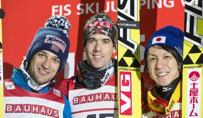 From left, Austria's Andreas Kofler, second placed, Norway's Anders Bardal, first placed, and Japan's Noriaki Kasai, third placed, pose on the podium at the end of the WC ski jump event in Trondheim, Norway, Friday March 7, 2014. (AP Photo/Ned Alley, NTB Scanpix)     NORWAY OUT Photo: Ned Alley / NTB scanpix