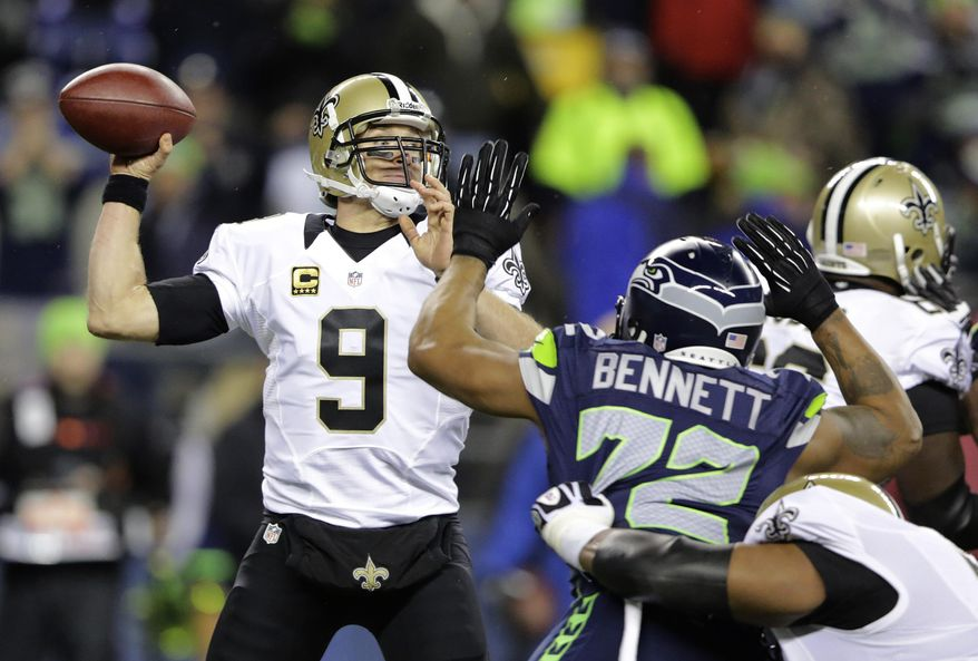 ADVANCE FOR WEEKEND EDITIONS, MARCH 8-9 - FILE - In this Dec. 2, 2013, file photo, New Orleans Saints quarterback Drew Brees (9) passes under pressure from Seattle Seahawks defensive end Michael Bennett (72) during an NFL football game in Seattle. NFL free agency begins Tuesday, March 11, 2014, with each team having another $10 million or so to spend thanks to the increased salary cap. Such standouts as receivers Eric Decker and Julian Edelman, defensive end Michael Bennett and cornerback Alterraun Verner figure to draw quick attention. (AP Photo/Scott Eklund, File)