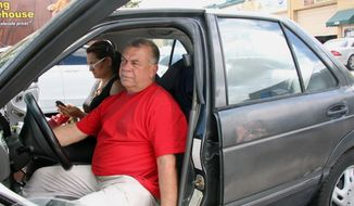 In this Wednesday, March 5, 2014, Carlos Salamanca tries to start his car in Miami. Salamanca fled Venezuela's increasingly political turmoil with his family in January. He is now living largely out of an old Nissan he purchased for $1,000. Salamanca was a small business owner in Venezuela and said he fled after receiving threats against his family. (AP Photo/Christine Armario)