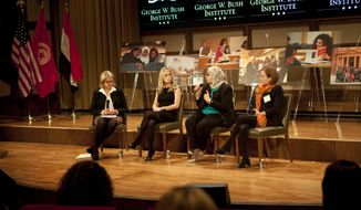 Margaret Spellings, left, Charity N. Wallace, second from left, Hadeer Maher, and Pam Allyn, right, speak in a moderated conversation during George W. Bush Institute's fellowship program on International Women's Day at the George W. Bush Presidential Center, March 7, 2014, in Dallas. (AP Photo/The Dallas Morning News, Sarah Hoffman)  MANDATORY CREDIT; MAGS OUT; TV OUT; INTERNET USE BY AP MEMBERS ONLY; NO SALES