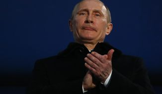 Russian President Vladimir Putin attends the opening ceremony of the 2014 Winter Paralympics at the Fisht Olympic stadium  in Sochi, Russia, Friday, March 7, 2014.  (AP Photo/Dmitry Lovetsky)