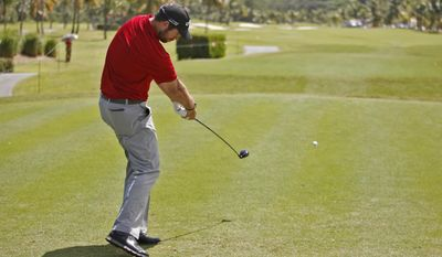 Bobby Gates of the U.S., hits the ball on the first hole during the second round of the Puerto Rico Open PGA golf tournament in Rio Grande, Puerto Rico, Friday, March 7, 2014. (AP Photo/Ricardo Arduengo)