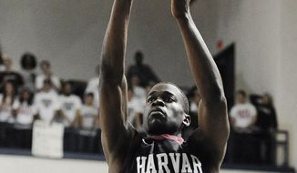 Harvard's Steve Moundou-Missi shoots during the first half of an NCAA college basketball game against Yale, Friday, March 7, 2014, in New Haven, Conn. (AP Photo/Jessica Hill)