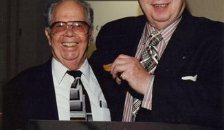 """This 1999 photo provided by the  Academy of Television Arts and Sciences shows Henry """"Hank"""" Rieger, left, with Tom Sarnoff, former presidents of the Television Academy, at Rieger's retirement ceremony in Los Angeles. Rieger, 95, died Wednesday, March 5, 2014, from old age in Oceanside, Calif, according to family members. In his 40 years with the TV academy, Rieger served as president of the Academy of Television Arts and Sciences, as well as president of the TV academy's Hollywood chapter and editor and publisher of Emmy magazine. (AP Photo/Academy of Television Arts and Sciences, Craig Mathew)"""