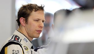 Brad Keselowski works in the garage during NASCAR Sprint Cup auto racing practice on Friday, March 7, 2014, in Las Vegas. (AP Photo/Isaac Brekken)