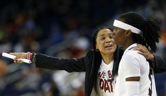 South Carolina  head coach Dawn Staley talks with South Carolina guard Khadijah Sessions (5) in the first half of a quarterfinal women's Southeastern Conference tournament NCAA college basketball game against Georgia Friday, March 7, 2014, in Duluth, Ga.  (AP Photo/John Bazemore)