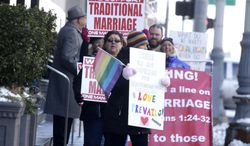 Supporters and protesters chant before closing arguments in the trial of two Detroit-area nurses, Jayne Rowse and April DeBoer, challenging Michigan's gay-marriage ban at the Theodore Levin Federal Court in Detroit Friday March 7, 2014. Michigan's ban on same-sex marriage was approved by voters in 2004.  Detroit federal Judge Bernard Friedman is not expected to make a decision Friday.  (AP Photo/Detroit Free Press, Mandi Wright)  DETROIT NEWS OUT;  NO SALES