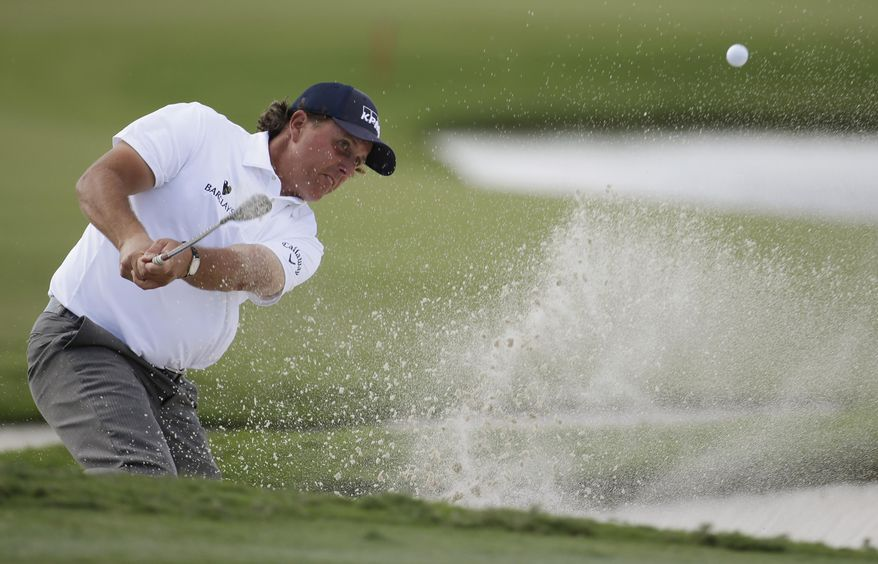 Phil Mickelson hits from a bunker on the ninth hole during the second round of the Cadillac Championship golf tournament, Friday, March 7, 2014, in Doral, Fla. (AP Photo/Lynne Sladky)
