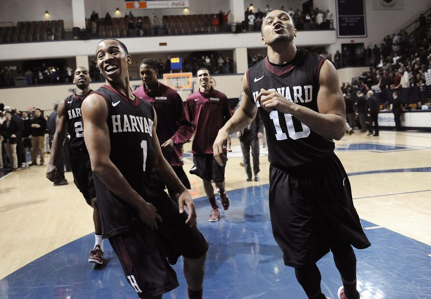 Harvard's Siyani Chambers, left, and Brandyn Curry, right, celebrate their 70-58 win over Yale at the end of an NCAA college basketball game, Friday, March 7, 2014, in New Haven, Conn. (AP Photo/Jessica Hill)