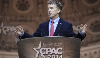 Sen. Rand Paul, R-Ky., speaks at the Conservative Political Action Committee annual conference in National Harbor, Md., Friday, March 7, 2014. Friday marks the second day of the annual Conservative Political Action Conference, which brings together prospective presidential candidates, conservative opinion leaders and tea party activists from coast to coast. (AP Photo/Susan Walsh)