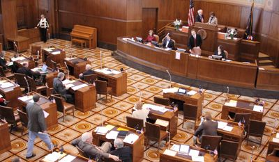The Oregon Senate meets on Thursday, March 6, 2014 at the state Capitol in Salem, Ore. The Legislature is pushing to adjourn as soon as Friday. (AP Photo/Chad Garland)