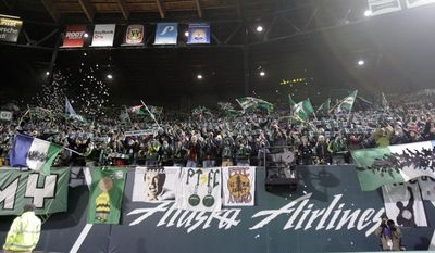 FILE - In this Nov. 24, 2013, file photo, Portland Timbers fans cheer during the second half of the second game of the Western Conference finals in the MLS Cup soccer playoffs against Real Salt Lake  in Portland, Ore. The Timbers host the Philadelphia Union in their season opening game on Saturday, March 8, 2014.  (AP Photo/Don Ryan, File)