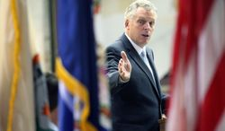 Gov. Terry McAuliffe speaks during a presentation at  Green Applications on Friday, March 7, 2014 in Gordonsville, Va.  Graphic art company Green Applications is planning to open a facility in Orange County, creating more than 320 jobs. McAuliffe announced Friday that the company plans to invest $9.75 million to establish its first Virginia operation in Gordonsville. Officials say the company will design, screen print, produce and distribute graphic art on heat transfers and apparel. (AP Photo/The Daily Progress, Ryan M. Kelly)