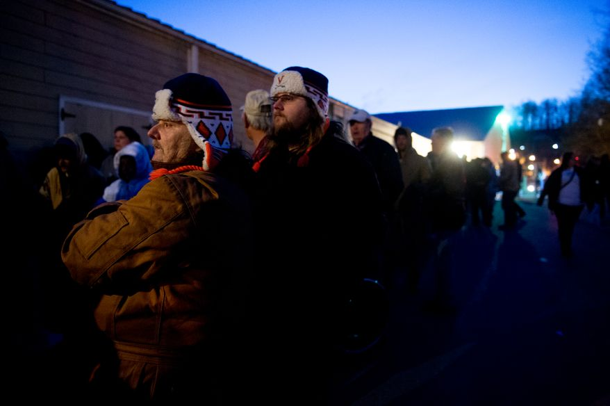 A crowd gathers in the cold pre-dawn hours to be let into the Remote Area Medical's facilities to be seen by a doctor at Southern Virginia University, Buena Vista, Va., Saturday, March 1, 2014. Remote Area Medical Volunteer Corps (RAM) is a Knoxville, Tennessee-based, non-profit, volunteer, airborne medical relief corps that provides free health care, dental care, eye care, veterinary services, and technical and educational assistance to people in remote areas of the United States, and around the world for people that need it. (Andrew Harnik/The Washington Times)