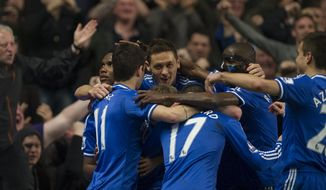 Chelsea's Samuel Eto'o left, celebrates with teammates after scoring against shoots Tottenham Hotspur, during their English Premier League soccer match, at the Stamford Bridge Stadium in London, Saturday, March 8, 2014. (AP Photo/Bogdan Maran)
