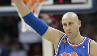 FILE - In this Dec. 2, 2009, file photo, Cleveland Cavaliers' Zydrunas Ilgauskas, of Lithuania, acknowledges the crowd while entering an NBA basketball game against the Phoenix Suns in Cleveland. Ilgauskas, a gentle giant who connected with Cleveland fans and became one of the city's most beloved athletes, will have his No. 11 jersey retired during halftime ceremonies Saturday, March 8, 2014, by the Cavaliers. (AP Photo/Tony Dejak, File)