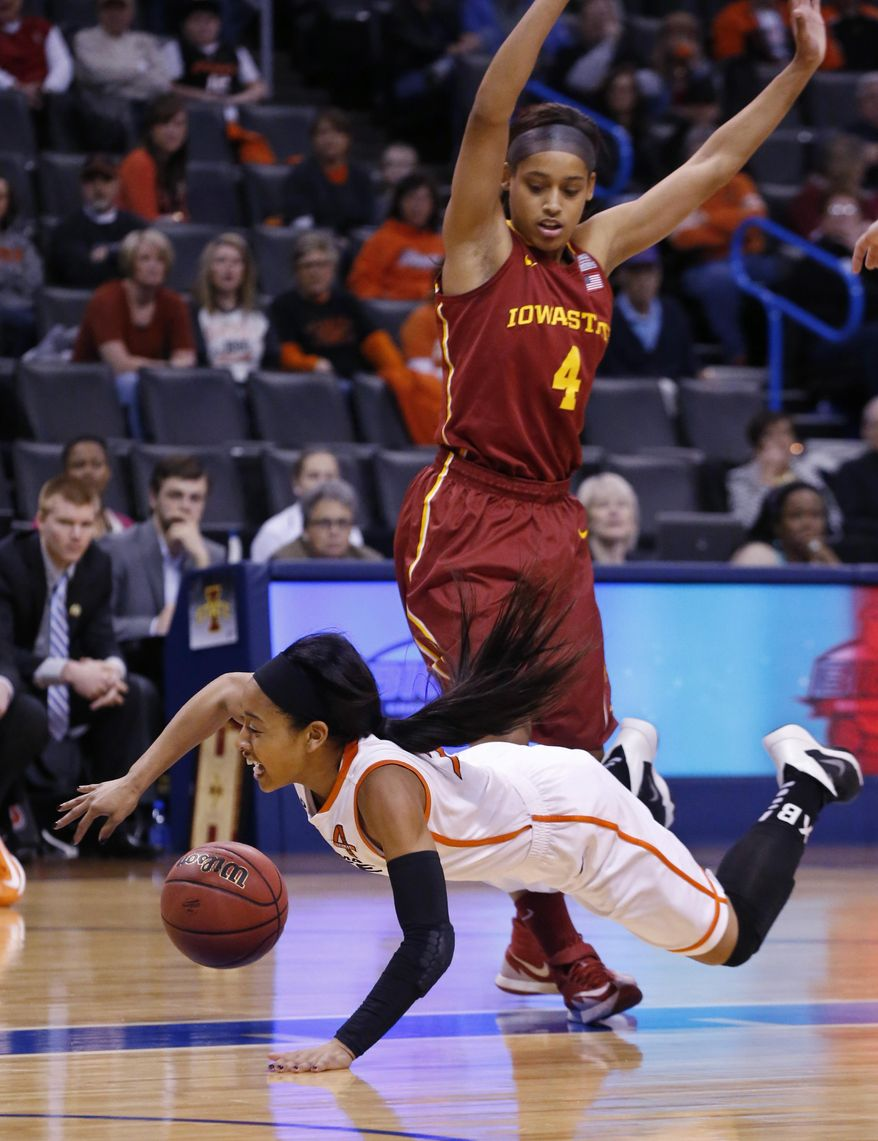 Oklahoma State guard Tiffany Bias (3) falls in front of Iowa State guard Nikki Moody (4) as she drives to the basket in the first half of an NCAA college basketball game in the quarterfinals of the Big 12 Conference women's college tournament in Oklahoma City, Saturday, March 8, 2014. (AP Photo/Sue Ogrocki)