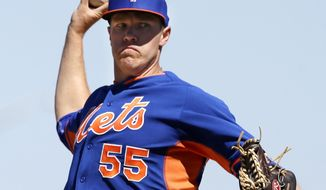 New York Mets starting pitcher Noah Syndergaard warms up during the second inning of an exhibition baseball game against the Detroit Tigers in Lakeland, Fla., Saturday, March 8, 2014. (AP Photo/Carlos Osorio)