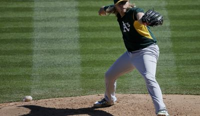Oakland Athletics starting pitcher A.J. Griffin throws against the Colorado Rockies during the second inning of a spring training baseball game in Scottsdale, Ariz., Saturday, March 8, 2014. (AP Photo/Chris Carlson)