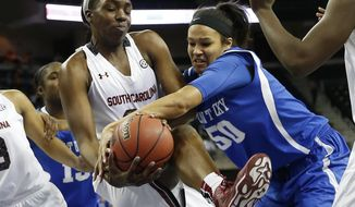 South Carolina center Elem Ibiam (33) and Kentucky forward/center Azia Bishop (50) battle for a rebound in the first half an NCAA college basketball game in the semifinals of the Southeastern Conference women's basketball tournament Saturday, March 8, 2014, in Duluth, Ga. (AP Photo/John Bazemore)