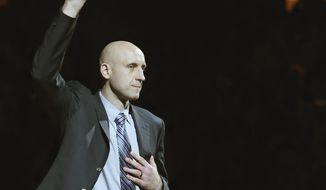 Zydrunas Ilgauskas is introduced during halftime of an NBA basketball game between the New York Knicks and the Cleveland Cavaliers on Saturday, March 8, 2014, in Cleveland. Soft-spoken and doggedly determined, Ilgauskas, who overcame serious injuries and personal tragedy to become one of Cleveland's best and most beloved players, had his No. 11 jersey retired Saturday night during an elaborate halftime ceremony certain to be emotionally poignant. (AP Photo/Tony Dejak)
