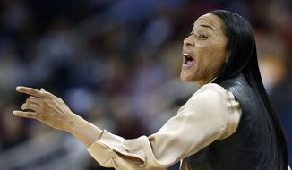 South Carolina  head coach Dawn Staley directs her team from the sideline in the second half of an NCAA college basketball game against Kentucky in the semifinals of the Southeastern Conference women's basketball tournament Saturday, March 8, 2014, in Duluth, Ga. (AP Photo/John Bazemore)
