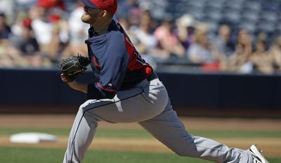 Cleveland Indians starting pitcher Tyler Cloyd throws during the first inning of an exhibition spring training baseball game against the San Diego Padres Saturday, March 8, 2014, in Peoria, Ariz. (AP Photo/Darron Cummings)