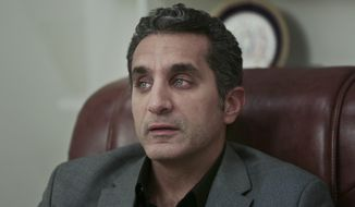 """FILE - In this Wednesday, Jan. 8, 2014 file photo, Egyptian Satirist Bassem Youssef speaks during an interview with The Associated Press in Cairo, Egypt. A Saudi-owned satellite network said on Saturday, March 8, 2014, that the signal of its Egyptian affiliate deliberately was jammed while it aired the country's top satirical program, Bassem Youssef's show, called """"The Program"""" in Arabic. (AP Photo/Nariman El-Mofty, File)"""