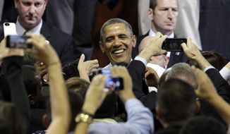 President Barack Obama greets people after speaking at Coral Reef High School, Friday, March 7, 2014 in Miami. Obama traveled to the Miami school to unveil a new initiative to ensure more students complete the Free Application for Federal Student Aid (FAFSA), a document required for most types of school financial aid such as Pell grants. (AP Photo/Javier Galeano)