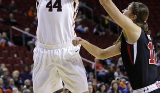 Oregon State's Ruth Hamblin (44) shoots over Utah's Emily Potter in the second half of an NCAA college basketball game in the Pac-12 women's tournament Friday, March 7, 2014, in Seattle. Oregon State won 50-35. (AP Photo/Elaine Thompson)