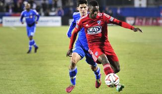 FC Dallas's Fabian Castillo traps the ball with his foot as Montreal's Eric Miller defends during an MLS soccer game Saturday, March 8, 2014, in Frisco, Texas. (AP Photo/The Dallas Morning News, Matthew Busch) MANDATORY CREDIT; MAGS OUT; TV OUT; INTERNET USE BY AP MEMBERS ONLY; NO SALES