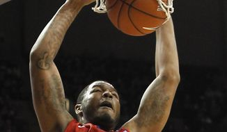 SMU forward Markus Kennedy (5) dunks the ball against Memphis in the first half of an NCAA college basketball game Saturday, March 8, 2014, in Memphis, Tenn. Memphis won 67-58. (AP Photo/Lance Murphey)
