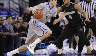 Creighton's Doug McDermott (3) drives around Providence's Josh Fortune (4) in the first half on an NCAA college basketball game in Omaha, Neb., Saturday, March 8, 2014. (AP Photo/Nati Harnik)