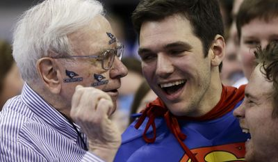 Billionaire investor Warren Buffett wears Creighton University stickers as he talks to Creighton students Nick Marnai of San Francisco, center, and Ryan Gardner of St. Louis, right, prior to an NCAA college basketball game against Providence in Omaha, Neb., Saturday, March 8, 2014. (AP Photo/Nati Harnik)