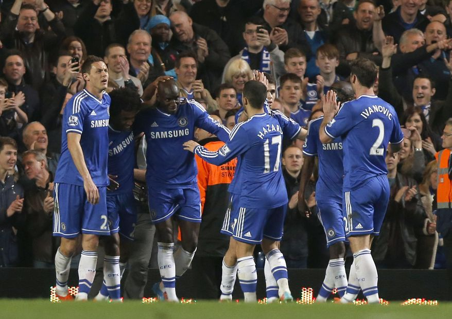 Chelsea's Demba Ba, third left, celebrates his goal against Tottenham Hotspur with teammates during their English Premier League soccer match at Stamford Bridge, London, Saturday, March 8, 2014. (AP Photo/Sang Tan)