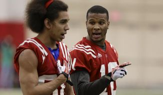 Nebraska wide receivers Kenny Bell (80) and Jamal Turner (10) talk after going through a drill on the first day of spring NCAA college football practice in Lincoln, Neb., Saturday, March 8, 2014. (AP Photo/Nati Harnik)