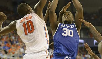 Kentucky forward Julius Randle (30) shoots as Florida forward Dorian Finney-Smith (10) defends during the second half of an NCAA college basketball game Saturday, March 8, 2014 in Gainesville, Fla. Florida won 84-65.  (AP Photo/Phil Sandlin)