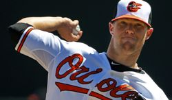 Baltimore Orioles starting pitcher Bud Norris warms up before the second inning of an exhibition spring training baseball game against the Boston Red Sox in Sarasota, Fla., Saturday, March 8, 2014. (AP Photo/Gene J. Puskar)